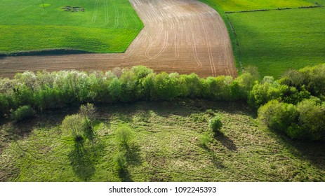 an aerial landscape in the countryside with at the bottom of cultivated fields
