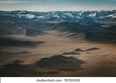 Aerial landscape of high barren mountains in Mongolia