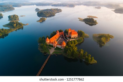 Aerial landscape with historic castle. Trakai castle from above, Lithuania. Beautiful view on Trakai complex castle with blue lakes and green islands.