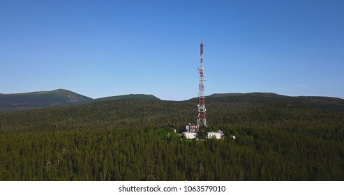 Aerial Landscape of a Nothern Nature. Radio TV Antenna Tower at the top of the Hill. Location Kola Peninsula in Russia near the Kandalaksha town