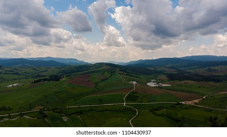 aerial landscape over the fields and rural road