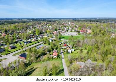 Aerial landscape over Swedish village in spring season