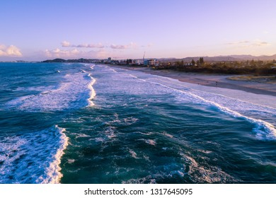Aerial landscape of Palm Beach suburb coastline at sunset. Gold Coast, Queensland, Australia