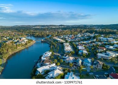 Aerial landscape of Reedy creek and luxury houses. Varsity Lakes, Gold Coast, Queensland, Australia