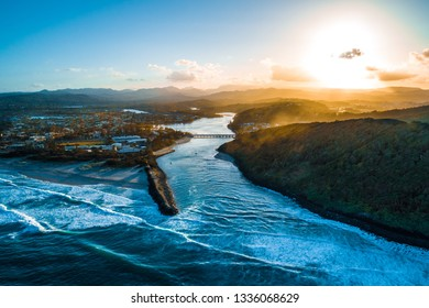 Aerial landscape of Tallebudgera river and Palm Beach suburb at sunset. Gold Coast, Queensland, Australia