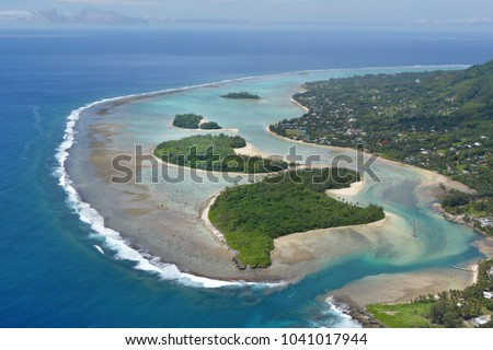 Aerial landscape view of the beautiful Muri Lagoon and it's Motus (Islets) in Rarotonga Island in the Cook Islands.