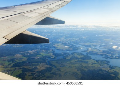 Aerial landscape. A view of the Earth's surface from a window of the flying plane