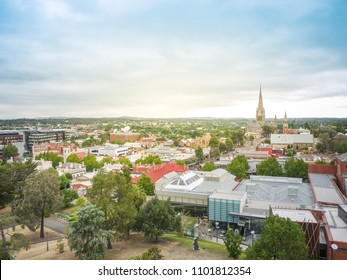 Aerial landscape view of the historic town Bendigo. Buildings and old church in town, and residential houses in distance. VIC Australia.