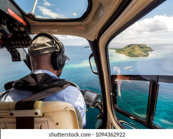 Aerial Landscape View from Inside Helicopter Looking Across Tropical South Pacific Island and Ocean Reef in Fiji