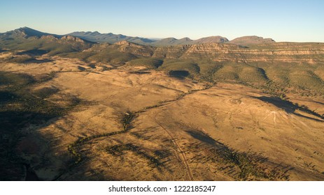 Aerial landscape view in the late afternoon of the Southern Escarpment of Wilpena Pound in the Flinders Ranges, South Australia.