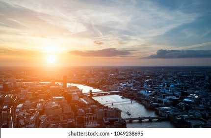 Aerial landscape view of London cityscape skyline with iconic landmark buildings in The City with dramatic sky
