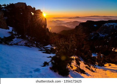 Aerial Landscape view from Ceahlău Mountains National Park at sunset in winter season,Sunset in Ceahlau Mountains
