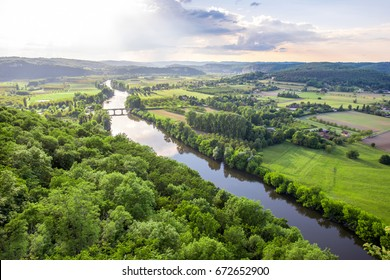 Aerial landscape view on Dordogne river with the old bridge and beautiful fields near Domme village in France