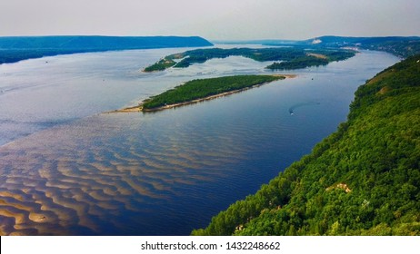 Aerial landscape view on Volga river with small sand islands and green forest, Samara, Russia