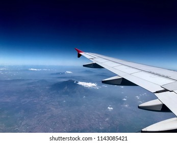 Aerial landscape and volcano view from airplane window