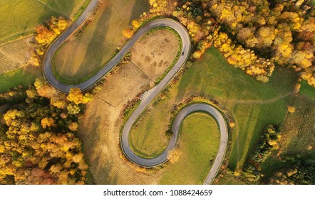 Aerial landscape - windy road in autumn scenery