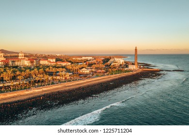 Aerial lighthouse view in Meloneras area on Gran Canaria island during magical sunset.