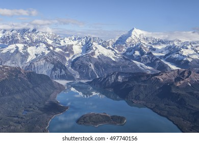 Aerial of Lituya Bay with Mt. Fairweather range in the background on a sunny day.