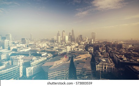Aerial London view on a foggy day from St Paul's cathedral - vintage styled photo