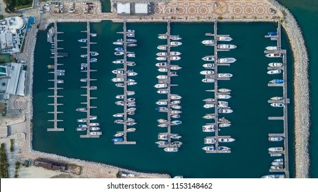 Aerial looking down at many dockedd boats in Colombia