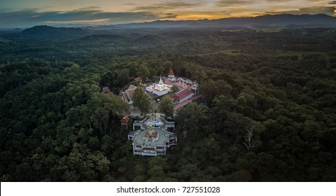 Aerial low light,sunset shot of Nan landmark, Wat Phra That Khao Noi, Old temple which you can see the top view of the Nan city from this temple