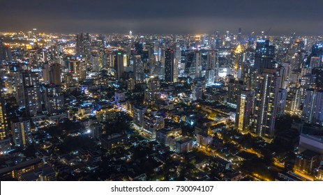 Aerial low-light, night shot of the business area in Bangkok City. The city that never sleep