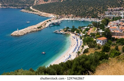 Aerial magnificent sea view skyline of blue beach in Kalkan city, Kas, Turquoise Coast of southwestern Turkey, surrounded by turquoise waters of the Mediterranean Sea.