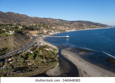 Aerial of Malibu Pier State Park, Surfrider Beach and Pacific Coast Highway near Los Angeles in scenic Southern California.