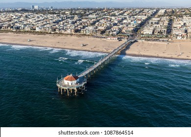 Aerial of Manhattan Beach Pier and the pacific ocean near Los Angeles California.
