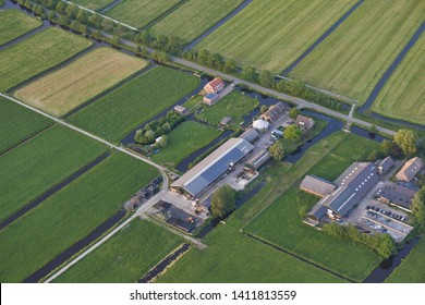 Aerial of modern farm with solar panels on the roof