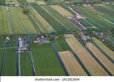 Aerial of modern farms with solar panels on the roof in dutch meadow landscape