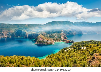 Aerial morning cityscape of Asos village on the west coast of the island of Cephalonia, Greece, Europe. Misty spring sescape of Ionian Sea. Traveling concept background.
