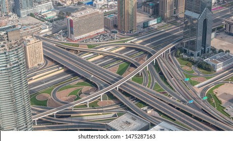 Aerial morning view of highway interchange in Dubai downtown timelapse after sunrise. Cityscapes traffic bridge, logistics. Roads and lanes Crossroads, Dubai, United Arab Emirates