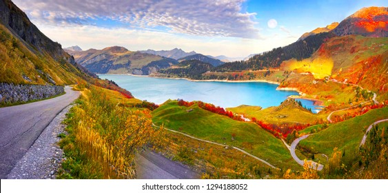 Aerial morning view of Roselend lake/Lac de Roselend. Picturesque autumn scene of Auvergne-Rhone-Alpes, France, Europe. Beauty of nature concept background.