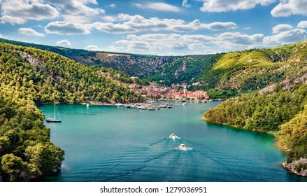 Aerial morning vire of Krka National Park, Prokljansko lake, Croatia, Europe. Picturesque summer cityscape of Skradin port. Beautiful world of Mediterranean countries. Traveling concept background.