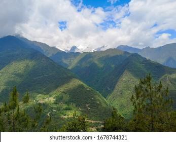 Aerial mountain view around Bingzhongluo Tibetan village. Three Parallel Rivers of Yunnan Protected Areas (World Heritage) in Gongshan, Nujiang, Yunnan, China.