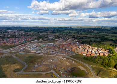 Aerial new housing estate construction on green belt land UK