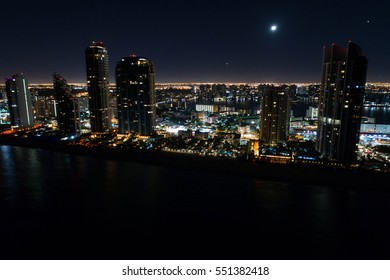 Aerial night image of a beachfront buildings