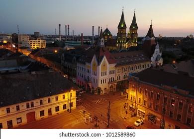 Aerial night image of Timisoara, Romania skyline from Piata Traian, featuring the Millenium Church