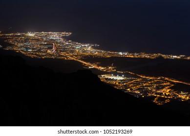Aerial night scene of Adeje village and las Americas touristic resort, Tenerife, Canary islands, Spain.