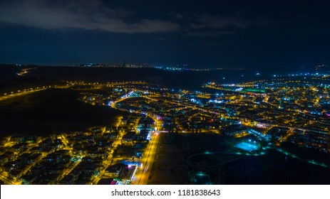 Aerial night shot of city lights at sunset. Ankara city in turkey. Aerial photography. Night city and lights. Night clouds long exposure.