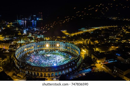 Aerial night shot of a Roman colosseum in the Croatian town of Pula. The great amphitheatre, Pula Arena, was constructed between 27 BC – 68 AD