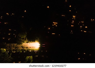 Aerial night view of All Saints' Day in Karveliskes cemetery in Lithuania. People remember their families deceased, visit them on cemeteries, light candles