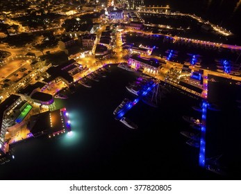 Aerial night view of the beautiful Marina in Limassol city in Cyprus. A very modern, high end and newly developed area where yachts are moored and it's perfect for a waterfront promenade.