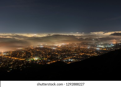 Aerial night view of fog over Los Angeles, Pasadena and Glendale in Southern California.