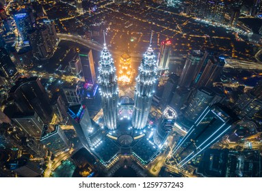 Aerial night view of KLCC or Petronas Towers, also known as the Petronas Twin Towers are twin skyscrapers in Kuala Lumpur. Kuala Lumpur, Malaysia. November 22, 2018.