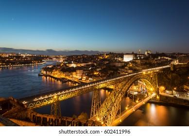 Aerial night view of Porto (Oporto),Duoro river and Dom Luis I Bridge from Mosteiro da Serra do Pilar