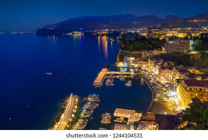 Aerial night view of rocky coastline Sorrento and Gulf of Naples - popular tourist destination in Italy.
