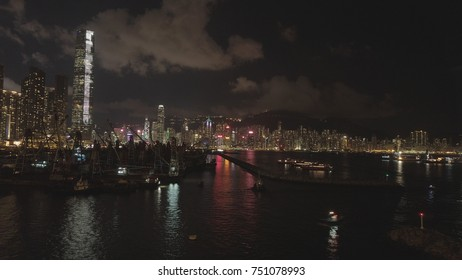 Aerial night view of the Yau Ma Tei Typhoon Shelter on a Full-moon night in Hong Kong
