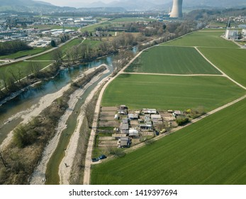Aerial of Nuclear Power Station and solar power panels and recreational areas close to Schönenwerd Bally Park Switzerland with agriculture and Aare River and SBB Eppenberg Tunnel under construction